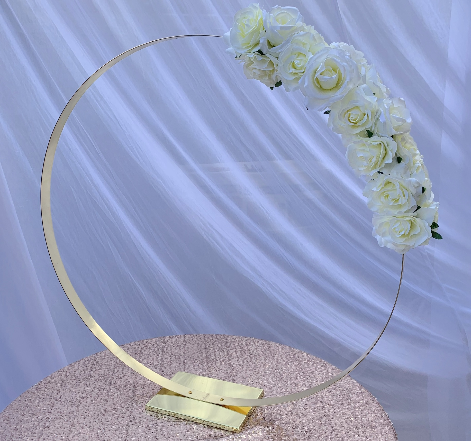 Gold ring centrepiece (floral designs optional). 80cm diameter, From £25