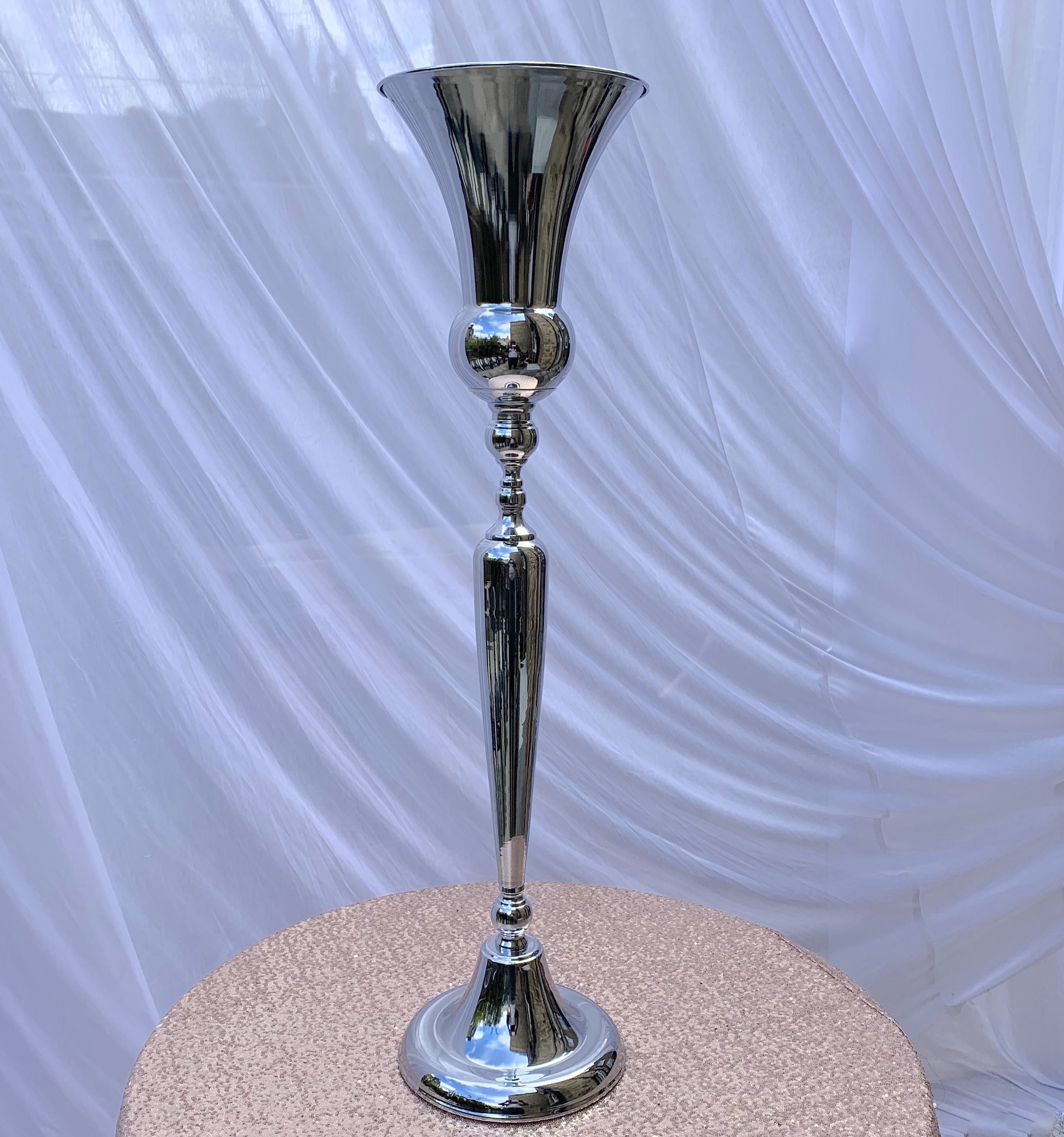 Tall silver vase,Height 1mtr, From £21
