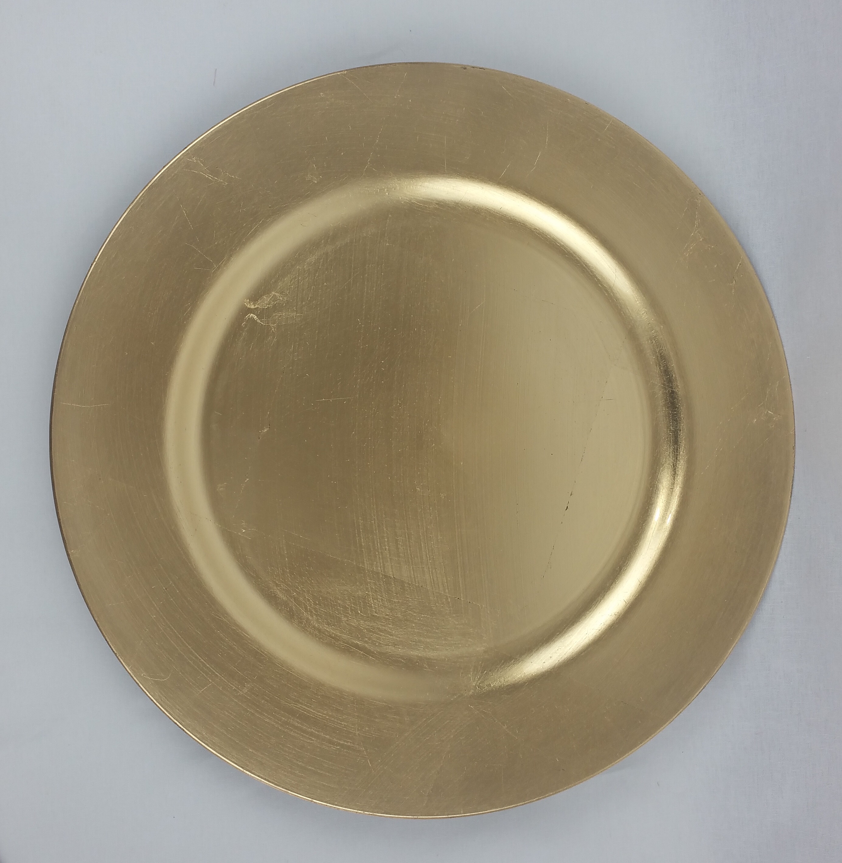 Gold charger plate (plastic). From £0.75p each.