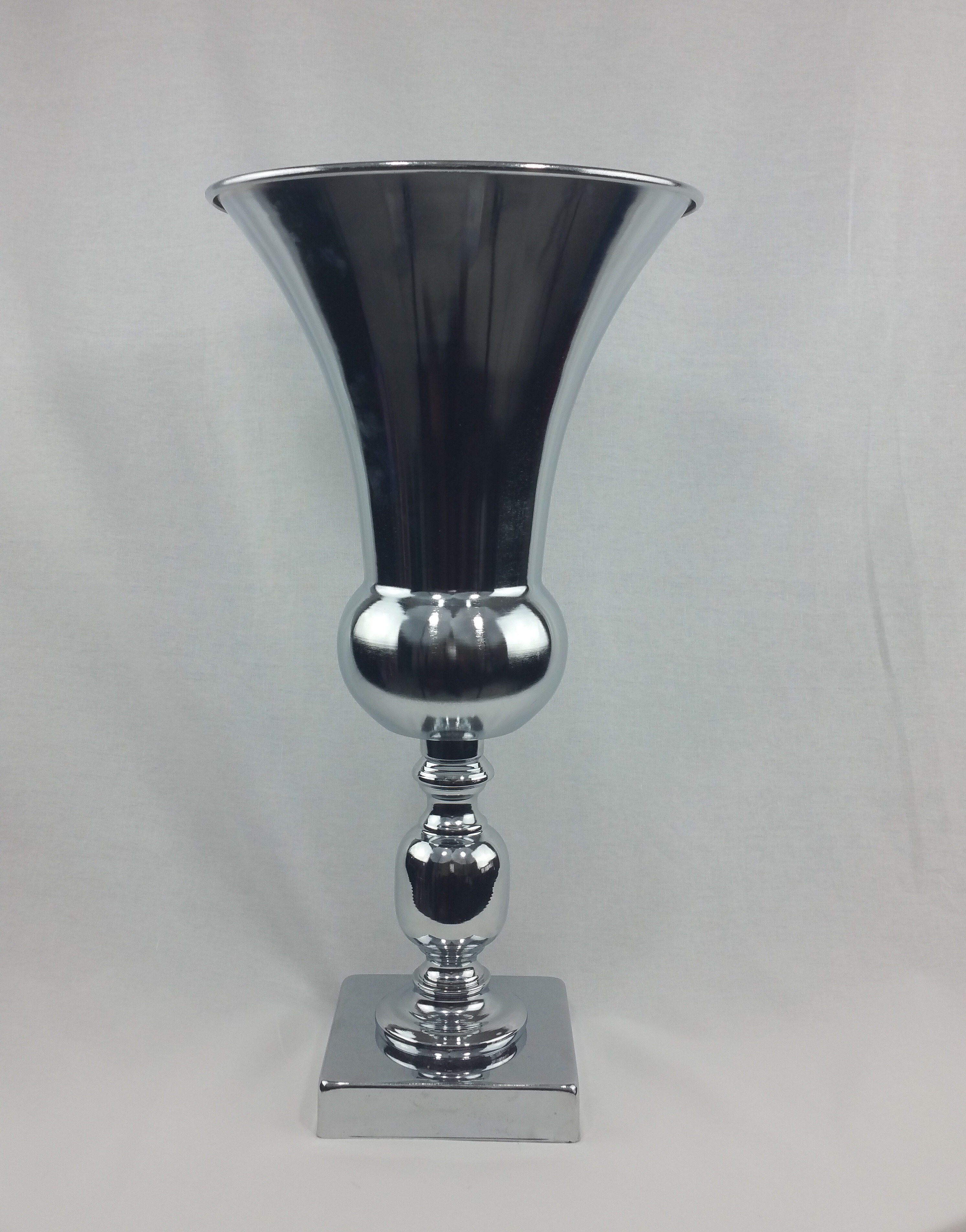 Silver urn. 50cm tall. From £12 each.