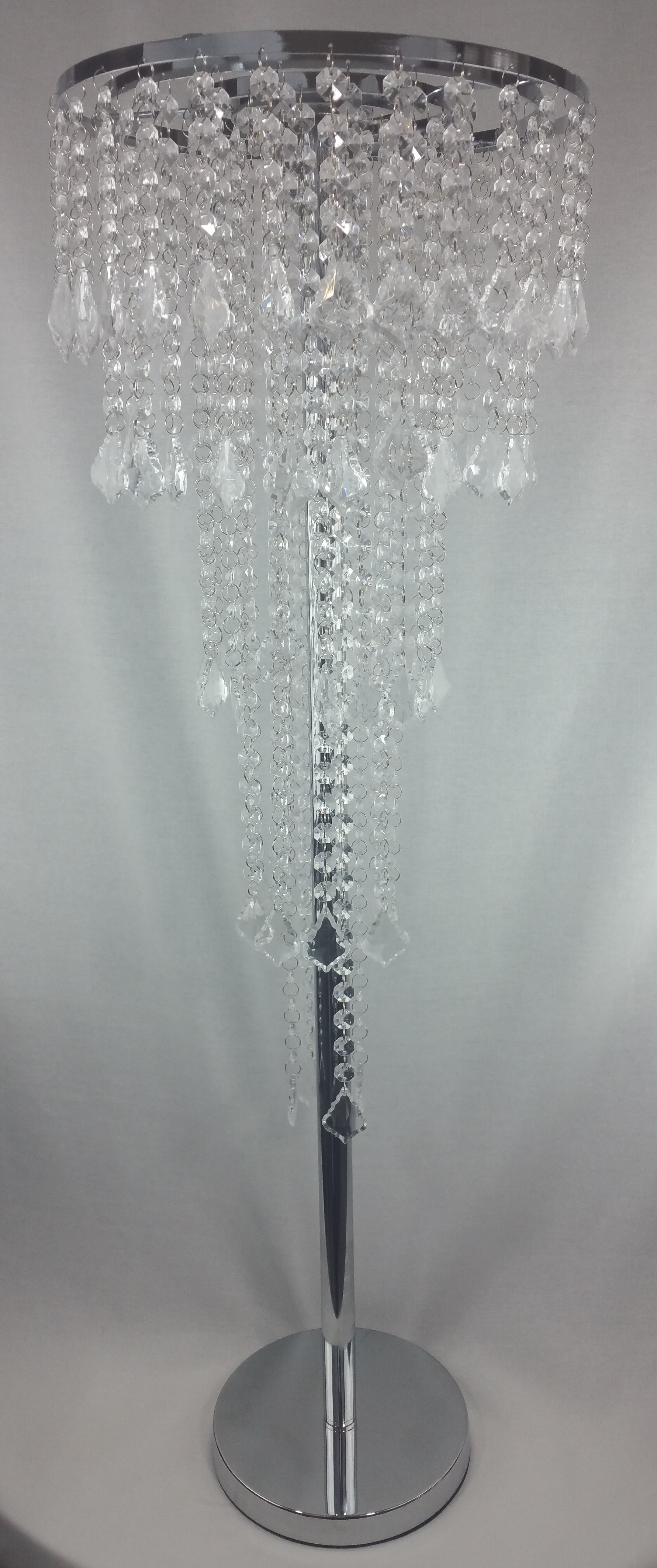 Silver crystal droplet centrepiece. 94cm tall. From £25 each.