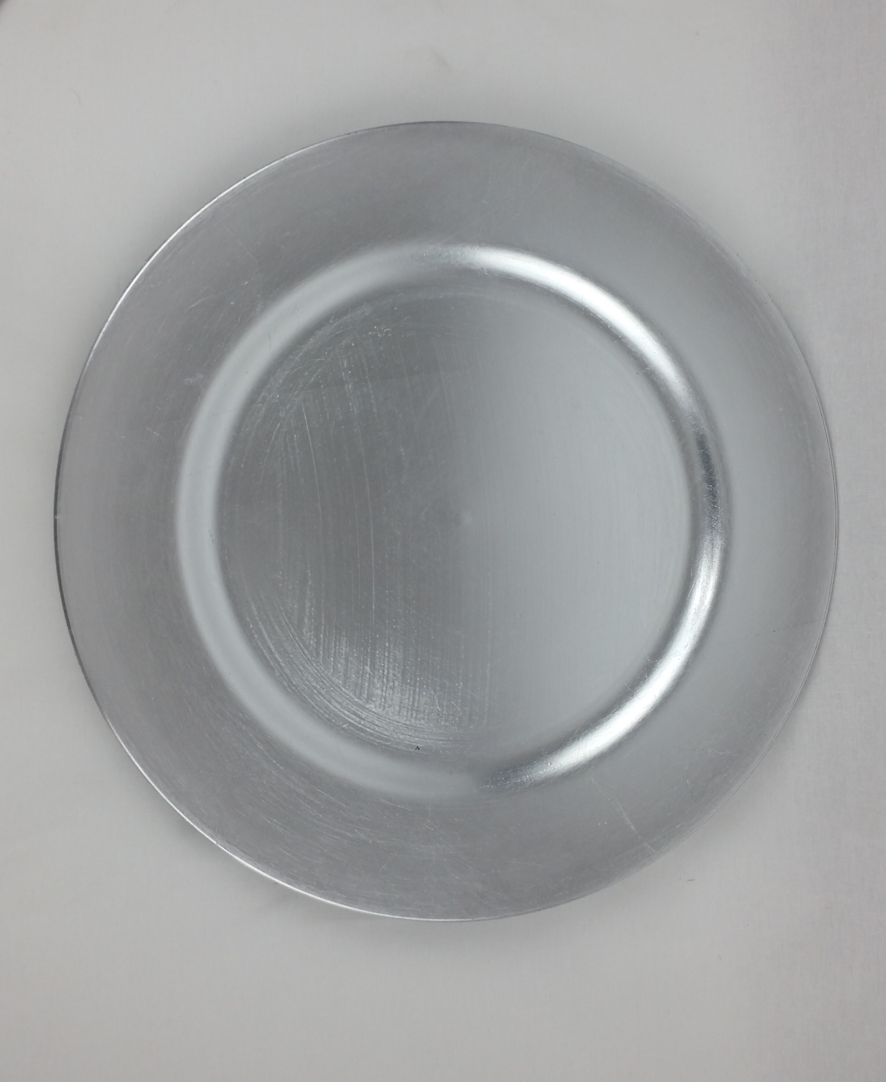Silver charger plate (plastic). From £0.75p each.