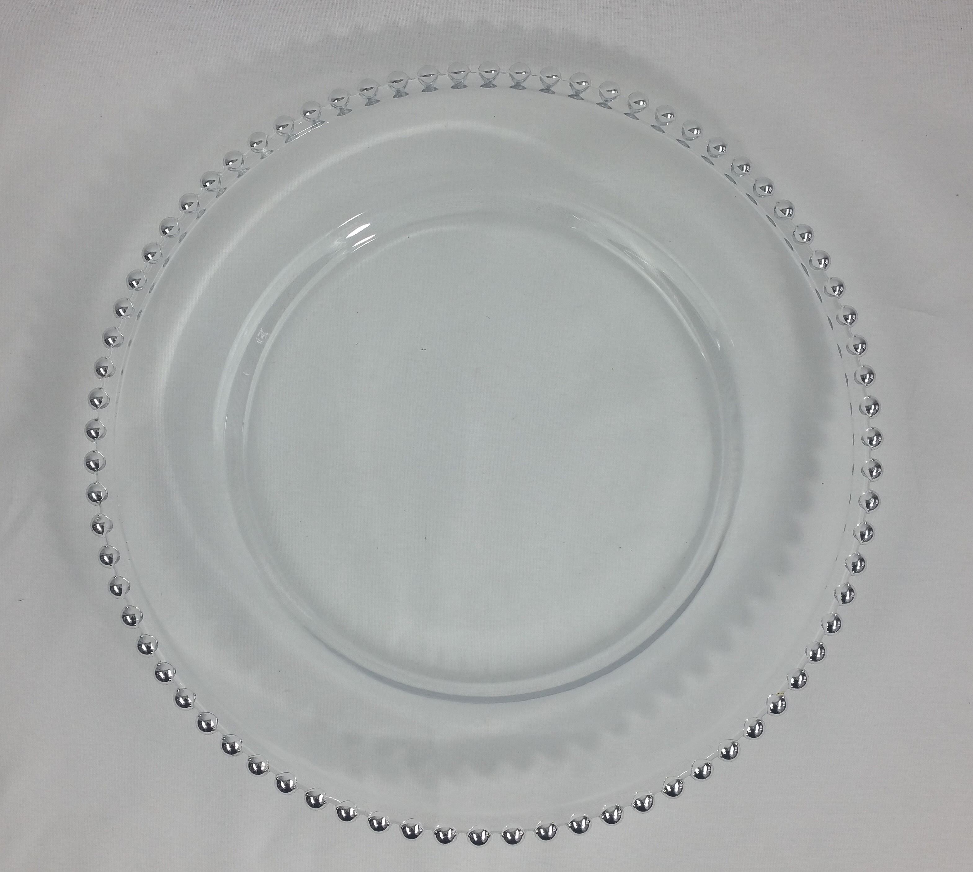 Silver beaded charger plate. From £1.85 each.