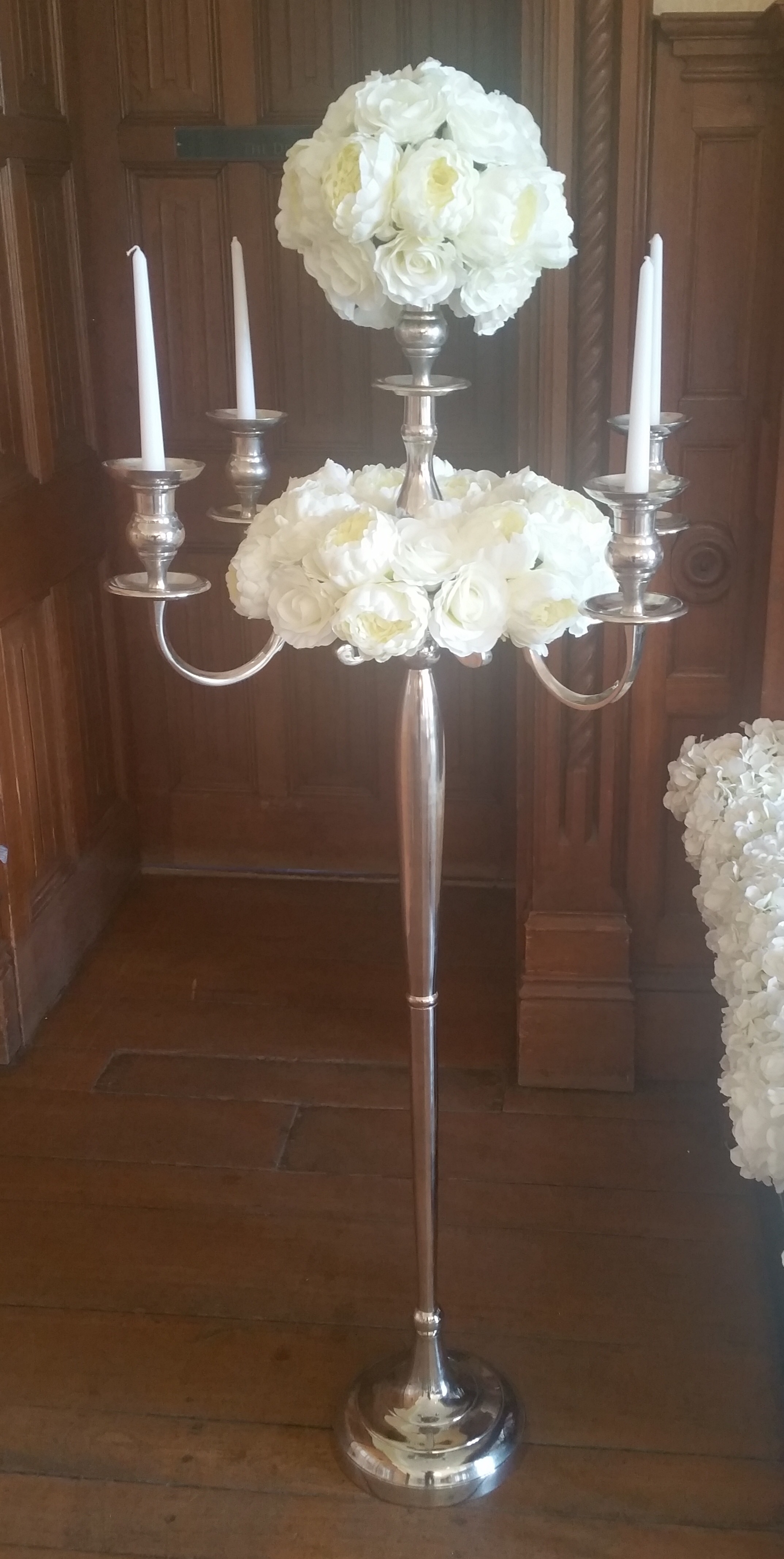 Floor standing candelabra (florals not included). From £50 each.