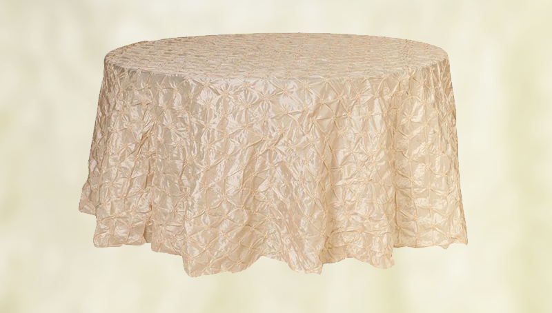 "Champagne pintuck tablecloth. 120"" round. From £15 each."