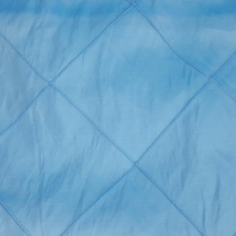 "Blue tablecloth with square design. 120"" round. From £12 each"